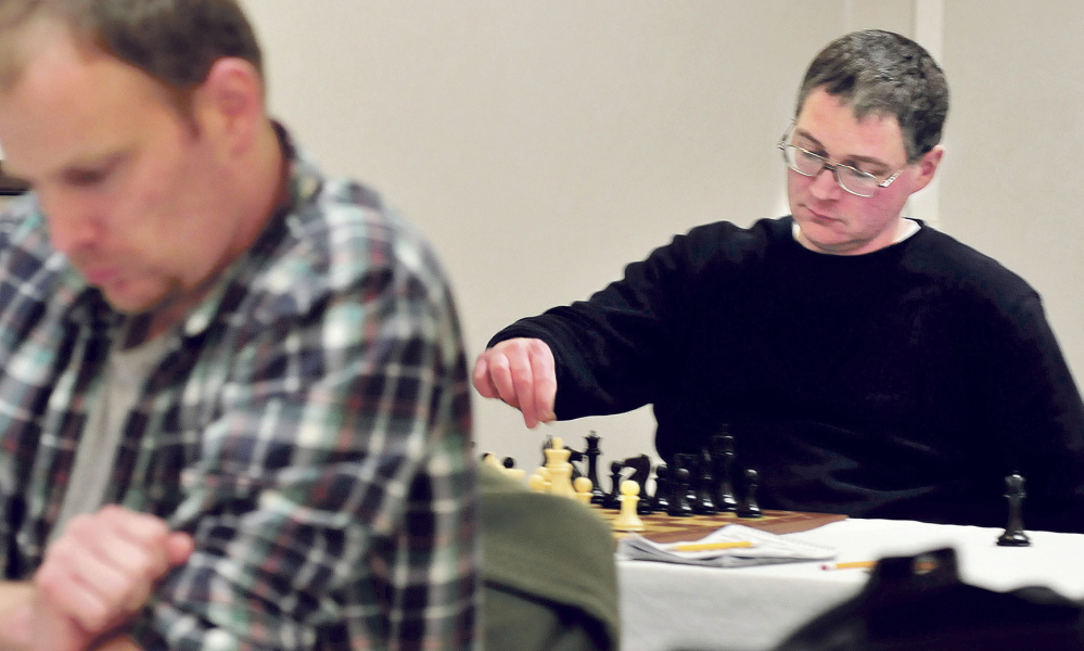 THE MOVE: Master chess player Jarod Bryan, right, of Augusta makes a move against Mathew Fishbein of Cape Elizabeth during the final match of the two-day main Closed Chess Championship on Waterville on Sunday. Bryan won his sixth state championship when he beat Fishbein.