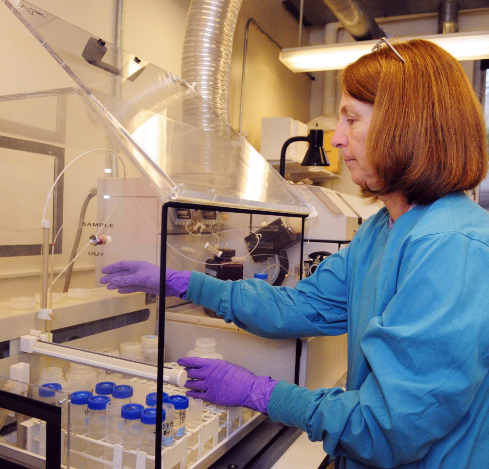 WELL TESTING: Chemist Cheryl Soucy runs water tests in the Maine Center for Disease Control and Prevention on Wednesday in Augusta. Soucy uses the inductively coupled plasma mass spectrometer to test water for arsenic and other contaminants.