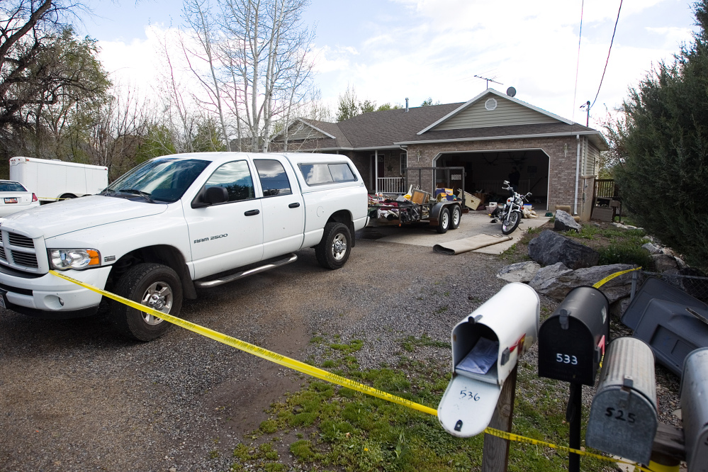 Authorities investigate a crime scene at a house in Pleasant Grove, Utah, where seven dead infants were found in the former home of Megan Huntsman, 39, Pleasant Grove Police Department said.
