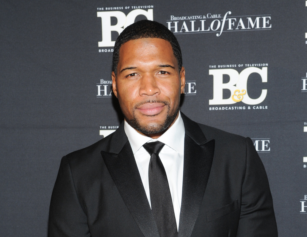 "The Associated Press This Oct. 28, 2013 file photo shows former professional football player Michael Strahan, co-host of ""Live with Kelly and Michael,"" attending the 23rd Annual Broadcasting & Cable Hall of Fame Awards in New York."