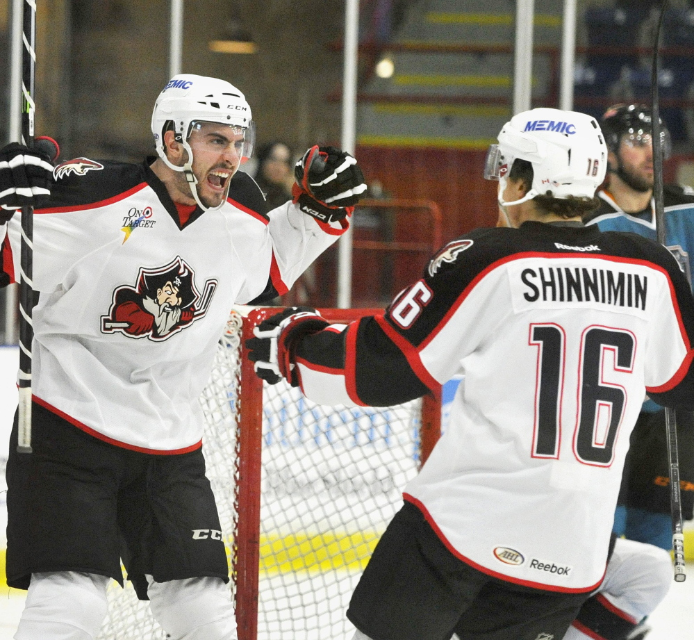 Portland's Lucas Lessio, left, and Brendan Shinnimin celebrate at The Androscoggin Bank Colisee, but the overall season was not one to relish.