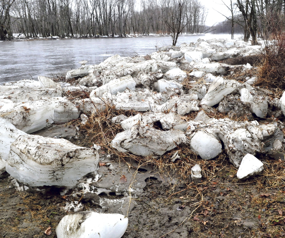 BREAK-UP: Larges chunks of ice are piled up on both sides of the raging Carrabassett River in New Portland on Tuesday.