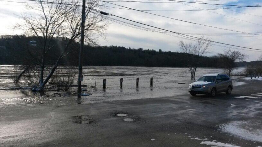 Floodwater covers Front Street in Hallowell on Wednesday morning. Some streets in both Hallowell and Augusta were closed Wednesday. The river is expected to recede Thursday.
