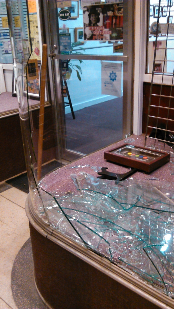 Broken: Smashed glass at Framemakers in downtown Waterville.