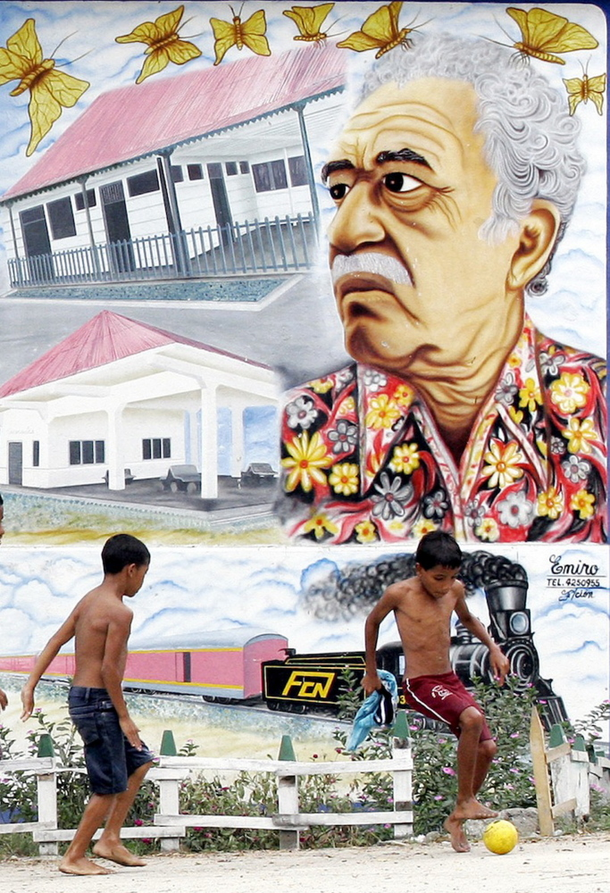 In this Jananuary 2006 file photo, boys play soccer in front a mural of Colombian Nobel laureate Gabriel Garcia Marquez in Aracataca, Colombia, the writer's hometown.