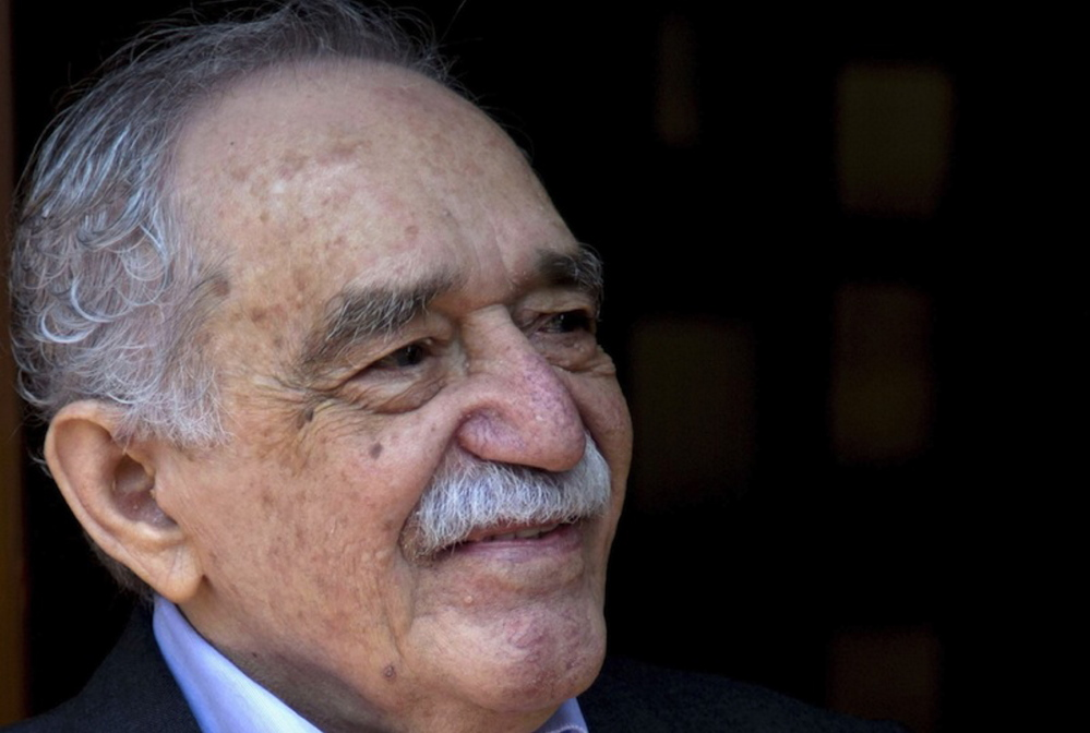 In this March 6, 2014 photo, Colombian Nobel Literature laureate Gabriel Garcia Marquez greets fans and reporters outside his home on his 87th birthday in Mexico City. Garcia Marquez died Thursday April 17, 2014 at his home in Mexico City.