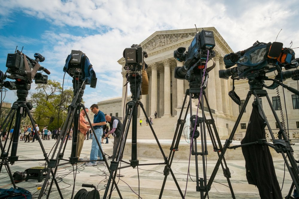 Videojournalists set up outside of the Supreme Court in Washington on Tuesday. The court heard arguments between TV broadcasters and Aereo Inc., a startup that gives subscribers Internet access to broadcast television.