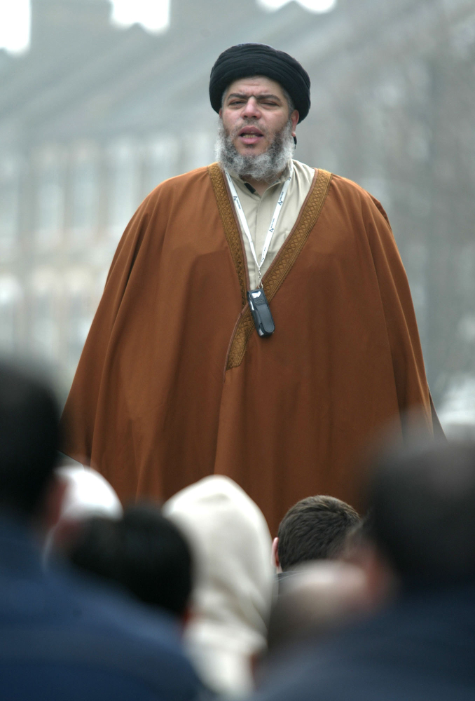Radical Muslim cleric Mustafa Kamel Mustafa prays in a street outside his Mosque in north London in this 2003 photo. Mustafa faces charges he conspired to support al-Qaida by trying in 1999 to set up a terrorist training camp in Bly, Ore., and by helping abduct two American tourists and 14 others in Yemen in 1998.