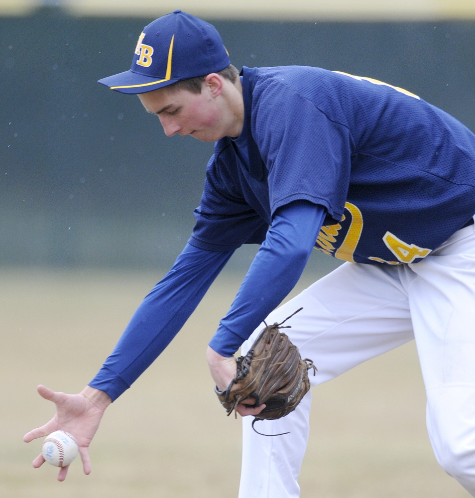Staff photo by Andy Molloy Mt. Blue's Amos Herrin collects a grounder with his throwing arm Wednesday at short stop during a baseball match up against Cony in Augusta.