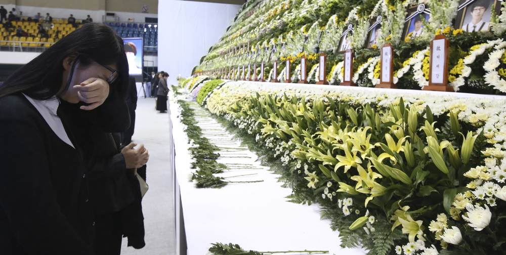 A mourner cries as she pays tribute to the victims of the sunken ferry Sewol Wednesday.
