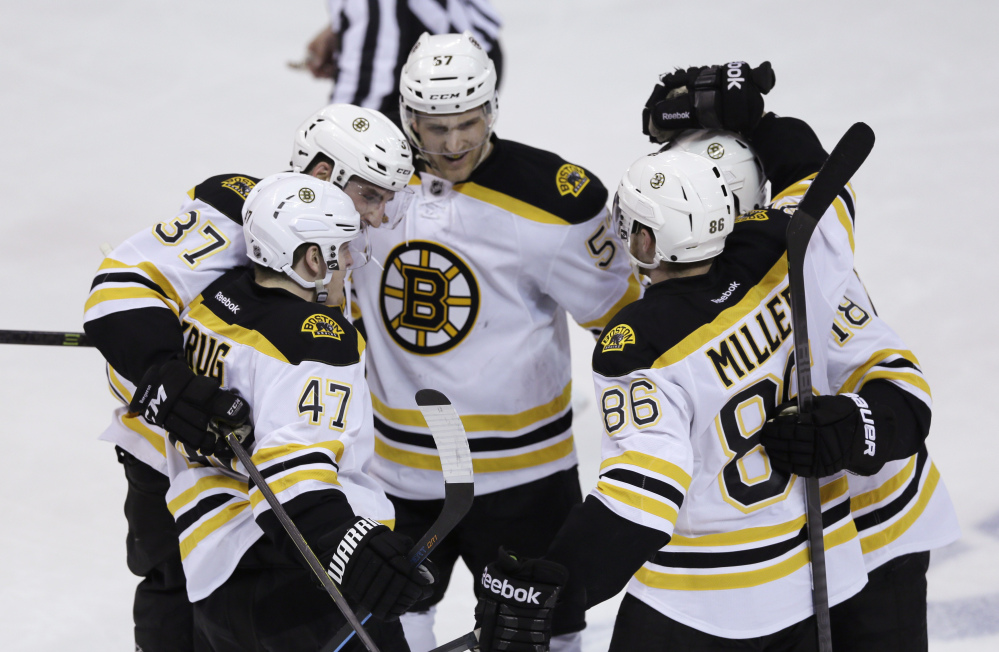 Boston Bruins, clockwise from foreground left, Torey Krug, Patrice Bergeron, Justin Florek, Reilly Smith and Kevan Miller celebrate Krug's goal in the second period Thursday.