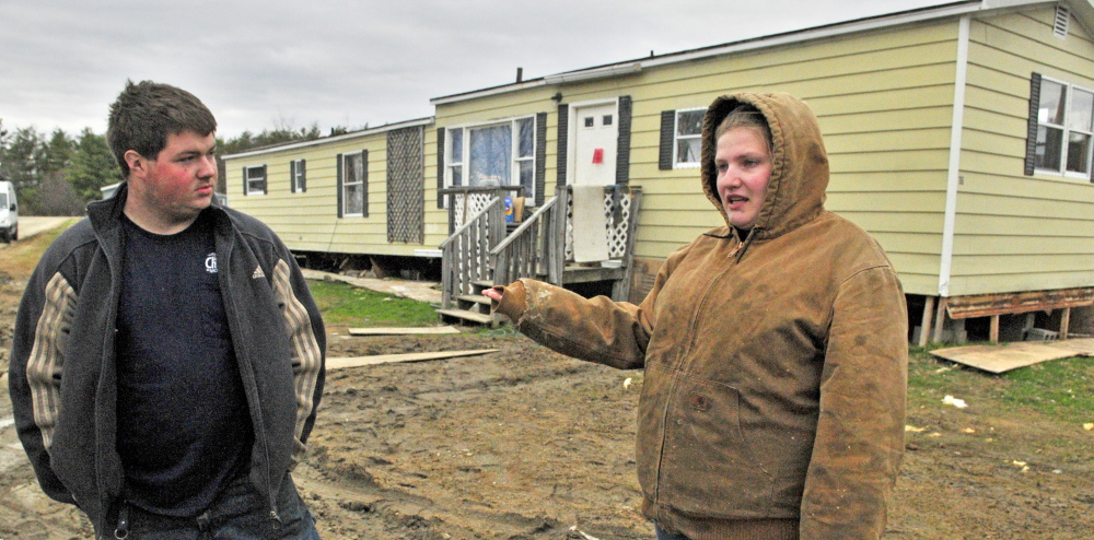 HAVE TO LEAVE: John Tuttle, left, and Harley Clifford talk about the problems they've had with water being shut off at Meadowbrook Trailer Park in Richmond.