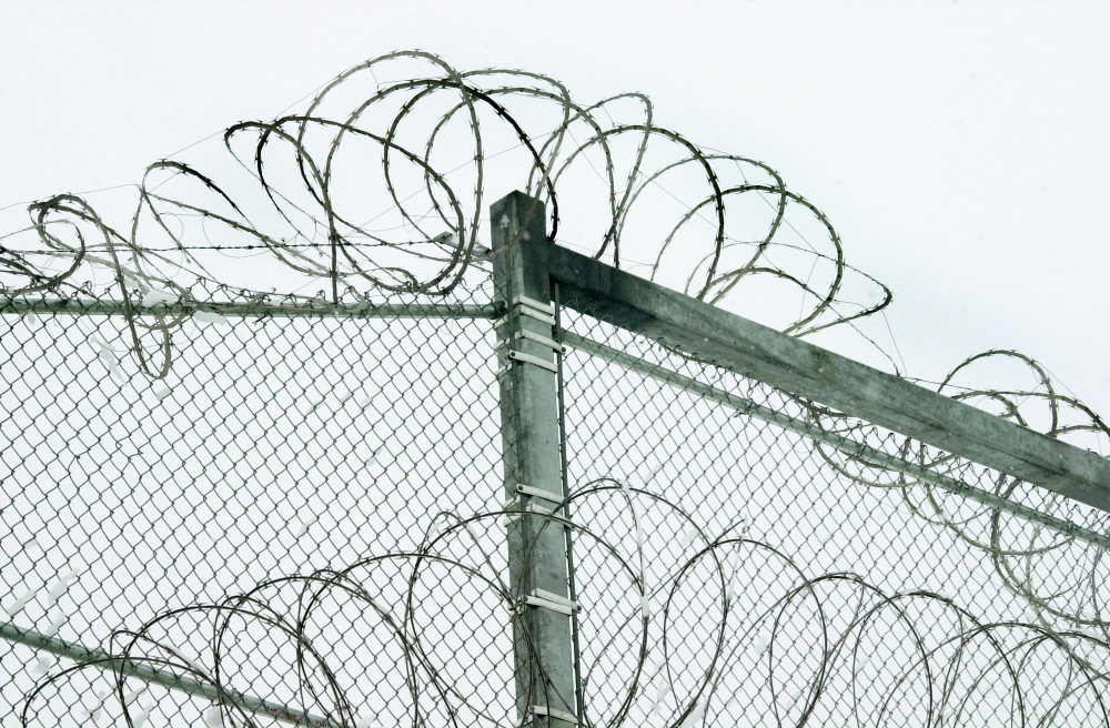 prison security: Razor wire is coiled along the top of the security fence at the Maine State Prison in Warren. State officials have made substantial improvements to policies on the use of segregation to punish disruptive inmates.