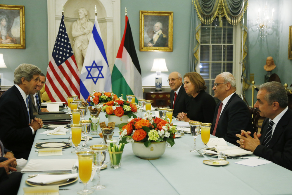 U.S. Secretary of State John Kerry, left, sits across from Israel's Justice Minister and chief negotiator Tzipi Livni, third right, Palestinian chief negotiator Saeb Erekat, second right, Yitzhak Molcho, an adviser to Israeli Prime Minister Benjamin Netanyahu, fourth right, and Mohammed Shtayyeh, aide to Palestinian President Mahmoud Abbas, right, at a dinner at the State Department in Washington that marked the resumption of Israeli-Palestinian peace talks last year. The talks are on the brink of collapse.