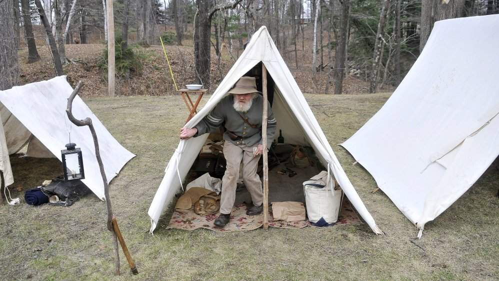 No plush accommodation: Tom Bassford, acting as a corporal with the Confederate Army's 15th Alabama Company, emerges from his tent Saturday at a common Civil War camp at Abbott Park in Farmington.