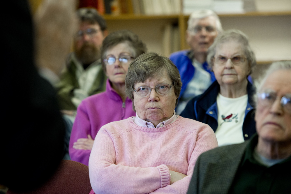 Sandra Barth of Boothbay, center, listens along with other seniors as Democratic gubernatorial candidate Mike Michaud talks about expanding Medicaid at a meeting at Boothbay Town Office on April 14. The issue of health care has emerged as source of sharp contrasts among the state's Blaine House contenders.
