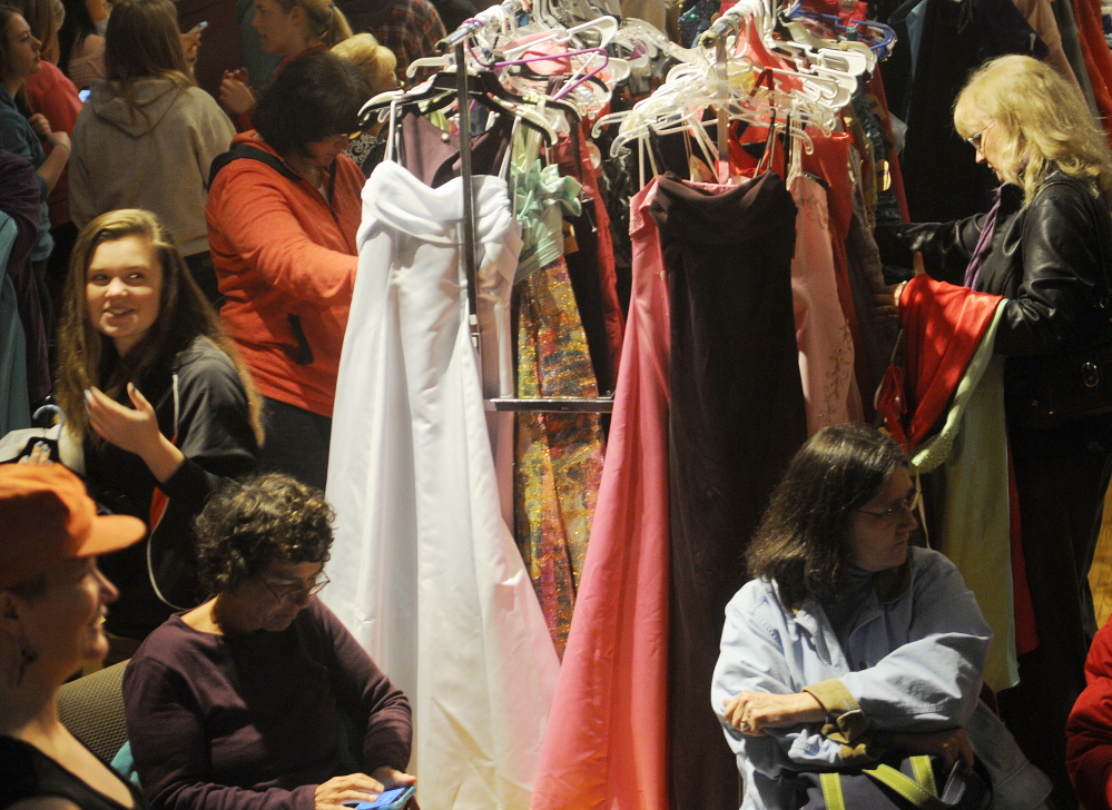 Dresses galore: People browse among prom dresses Saturday during the Cinderella Project at Johnson Hall in Gardiner. More than 100 teenage girls picked donated dresses, shoes and jewelry during the event.