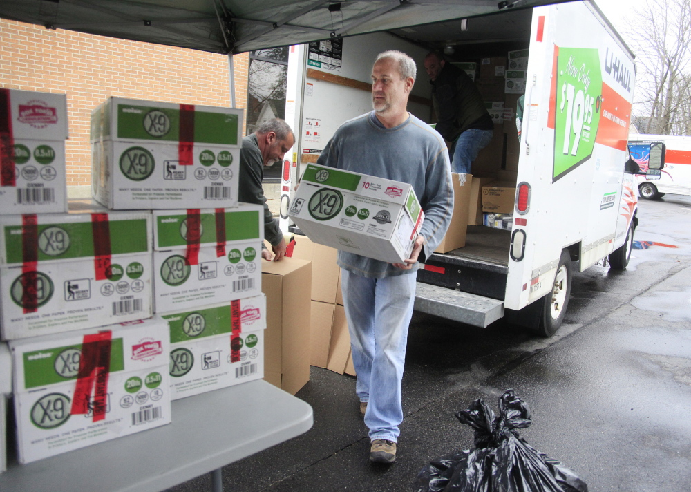 Paul Wolf and members of the Maine Drug Enforcement Administration load boxes of discarded drugs in Portland on Saturday. Three U-Haul trucks were filled with boxes of drugs to be taken to a high-tech waste to energy facility in Massachusetts for incineration.