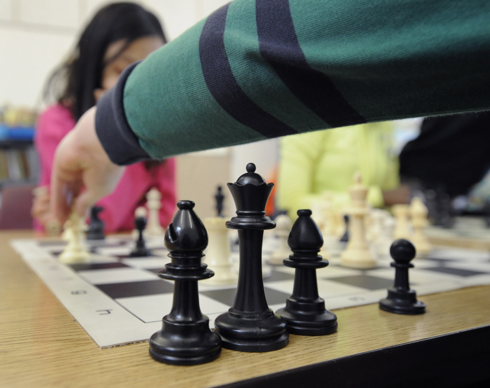POVERTY DISRUPTS EDUCATION: A chess tournament at Portland's East End School, where 74 percent of students qualify for nutrition assistance. It's no coincidence that this school got an F in last year's state rankings: Most students who live in stressed environments aren't equipped to learn at a high level.