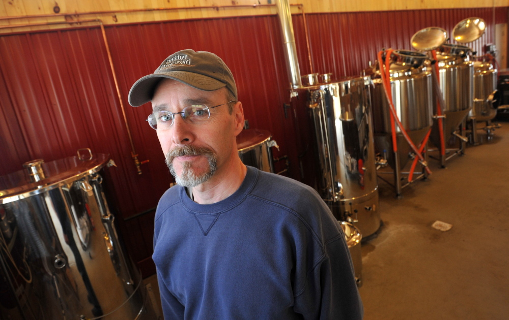 Staff photo by Michael G. Seamans Jeff Powers, owner of Bigelow Brewing Company, stands among his vats in his brewery in Skowhegan on Tuesday. Bigelow Brewing Company has an open house on Saturday at the 473 Bigelow Hill Road location and will be offering free samples.