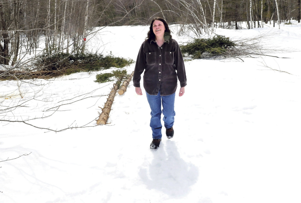 GROWING: Samantha Burns, manager of the Madison Farmer's Market, walks through a field cleared for vegetable gardens at her farm in Anson in early April.