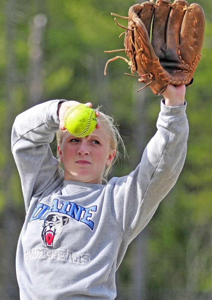 Staff photo by Joe Phelan Cony pitcher Arika Brochu throws long toss during practice on Tuesday April 29, 2014 at Cony Family Field in Augusta.