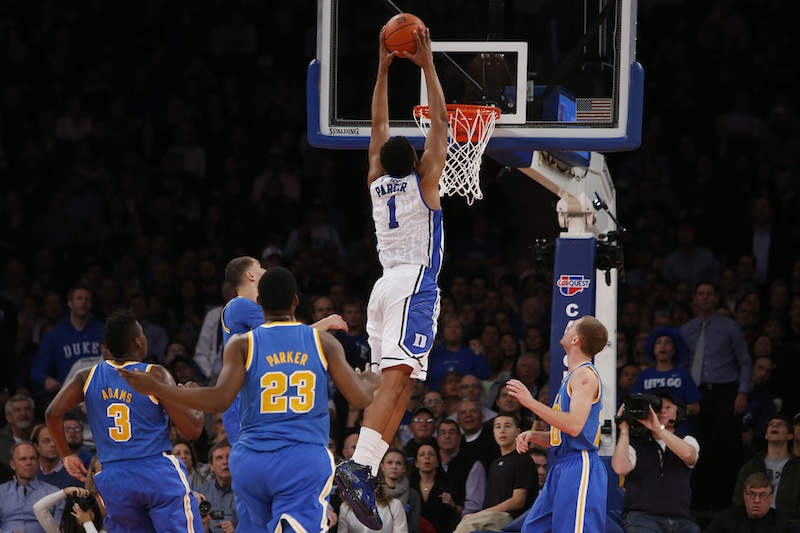 In this December 2013 file photo, Duke's Jabari Parker (1) dunks against UCLA during the second half of an NCAA college basketball game. Parker has announced he will enter the NBA Draft after one season at Duke. Men's college basketball;College basketball;Basketball;Sports;Men's basketball;College sports;Men's sports