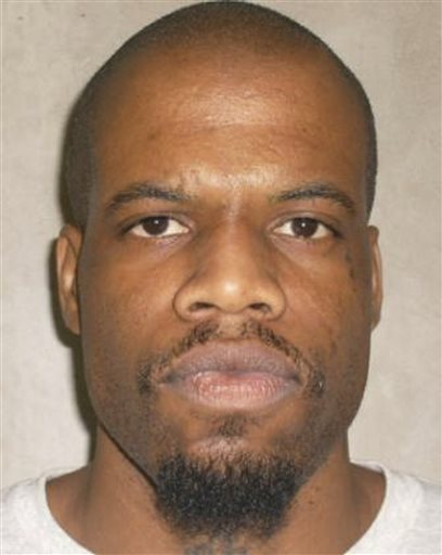 This 2011 photo provided by the Oklahoma Department of Corrections shows Clayton Lockett. Oklahoma prison officials halted the execution of Lockett Tuesday after the delivery of a new three-drug combination failed to go as planned.
