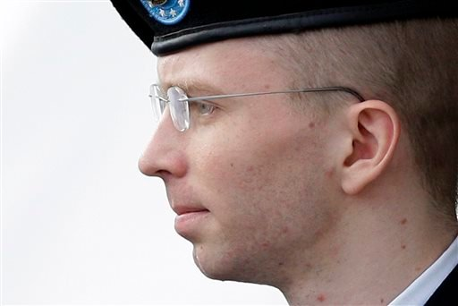 Army Pfc. Bradley Manning, who now is known as Chelsea Manning, is escorted to a security vehicle in Fort Meade, Md., after a hearing in his court-martial, in this Aug. 20, 2013, photo.
