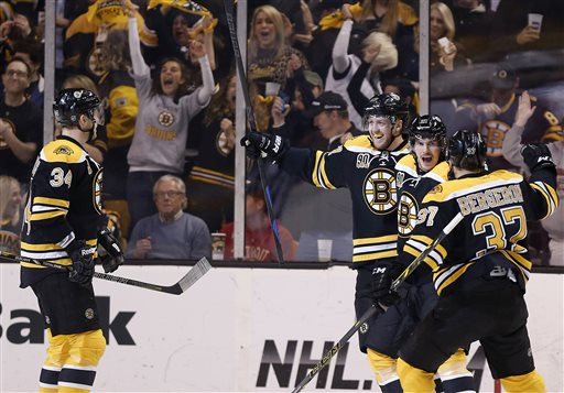 Boston Bruins' Loui Eriksson, second from right, celebrates his goal with teammates during the first period in Game 5 in the first round of the Stanley Cup playoffs against the Detroit Red Wings in Boston on Saturday.