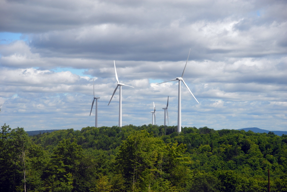 First Wind turbines spin on Stetson Mountain. The Maine Board of Environmental Protection took a preliminary step Thursday toward rejecting a wind farm in Penobscot County.