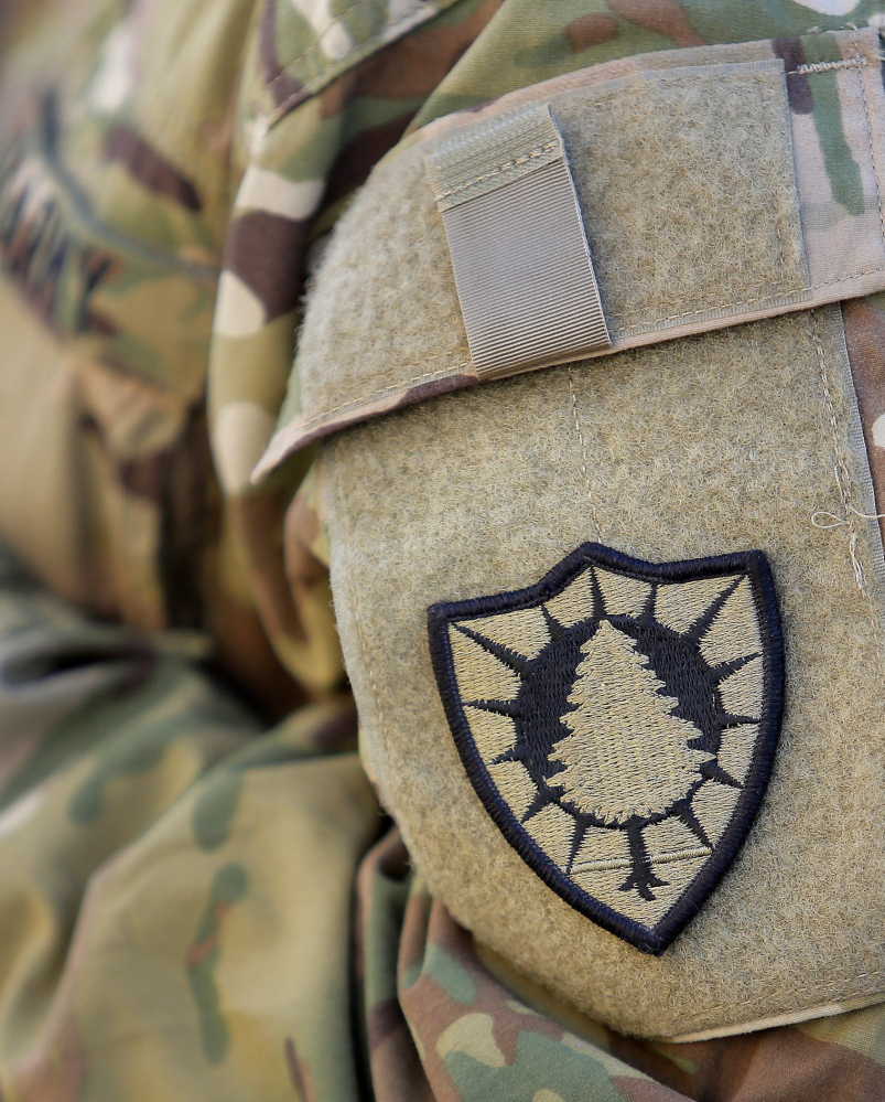 Sgt. Jessica Kurka of Durham wears the 133rd's pine tree patch at an airfield in Afghanistan last year.