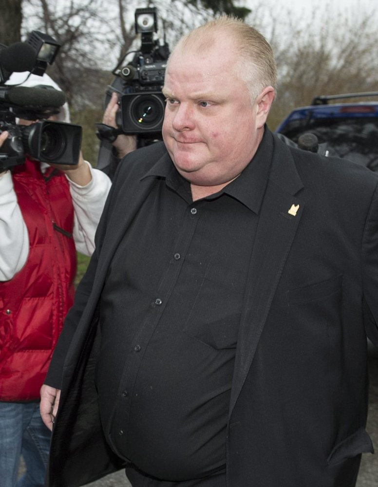 Rob Ford leaves his home early Thursday in Toronto. A second video reportedly shows him smoking crack.