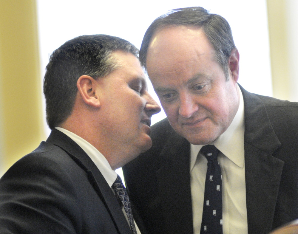 Senate Minority Leader Michael Thibodeau, R-Winterport, left, confers with Sen. Andre Cushing, R-Hampden, ahead of a vote Thursday in the Senate in Augusta. Members of the House and Senate took up 48 bills vetoed by Gov. Paul LePage.