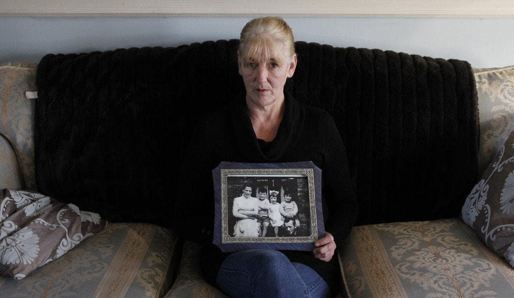 Helen McKendry holds a family photograph showing her mother, Jean McConcille, at home in Killyleagh, Northern Ireland. She has long sought an Irish Republican Army admission of responsibility in her mother's death and help in finding her remains.