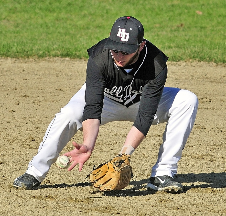 Staff photo by Joe Phelan Hall-Dale second baseman Alex McPherson fields a ball during a game on Friday May 2, 2014 at Hall-Dale High School in Farmingdale.