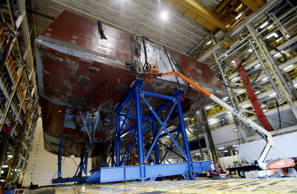 Work is underway on the stern of a DDG-1000 Zumwalt destroyer at Bath Iron Works in Bath on Thursday. Although most new workers have experience or training in their field, shipyard officials have created a facility to help workers tailor their skills to the yard's needs.