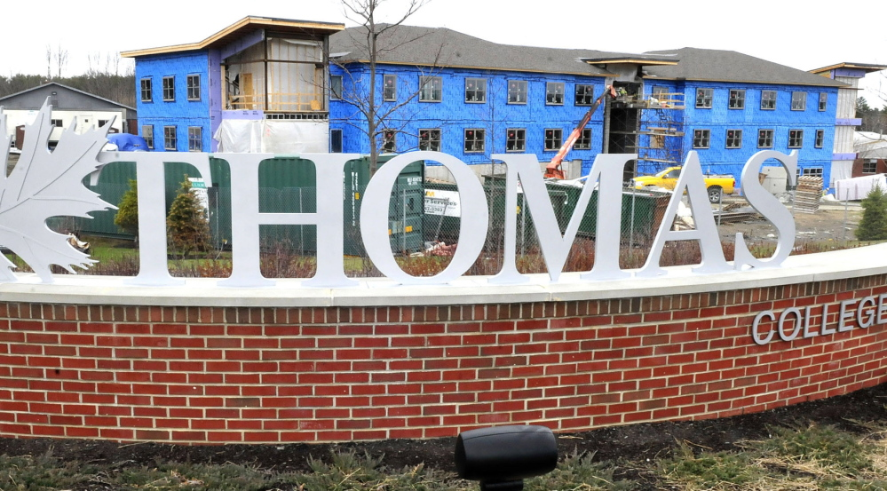 VACANCY: Construction workers build the new residential hall at Thomas College in Waterville.