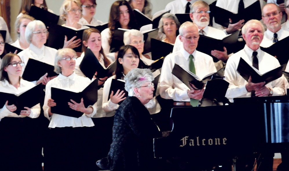 FOND MEMORY: Pianist Patricia Hayden, wife of the late Joel Babcock Hayden Jr., plays as the UMF Community Chorus sings at the University of Maine in Farmington campus during a tribute to Joel Hayden on Sunday.