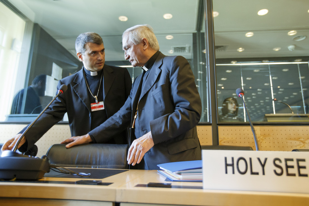 Archbishop Silvano M. Tomasi, right, Apostolic Nuncio, permanent observer of the Vatican to the Office of the United Nations in Geneva, speaks with Monsignor Christophe El-Kassis before the U.N. torture committee hearing on the Vatican, in Geneva, Switzerland, on Monday.