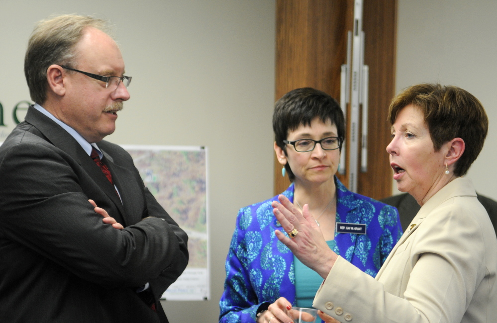 NEW WATER TOWER: Department of Environmental Protection Commissioner Patricia Aho, right, speaks Monday with Rep. Gay Grant, D-Gardiner, and New England Region Environmental Protection Agency Administrator Curt Spalding at city hall in Gardiner following the announcement of a $1.5 million loan to build a water tower in Farmingdale.