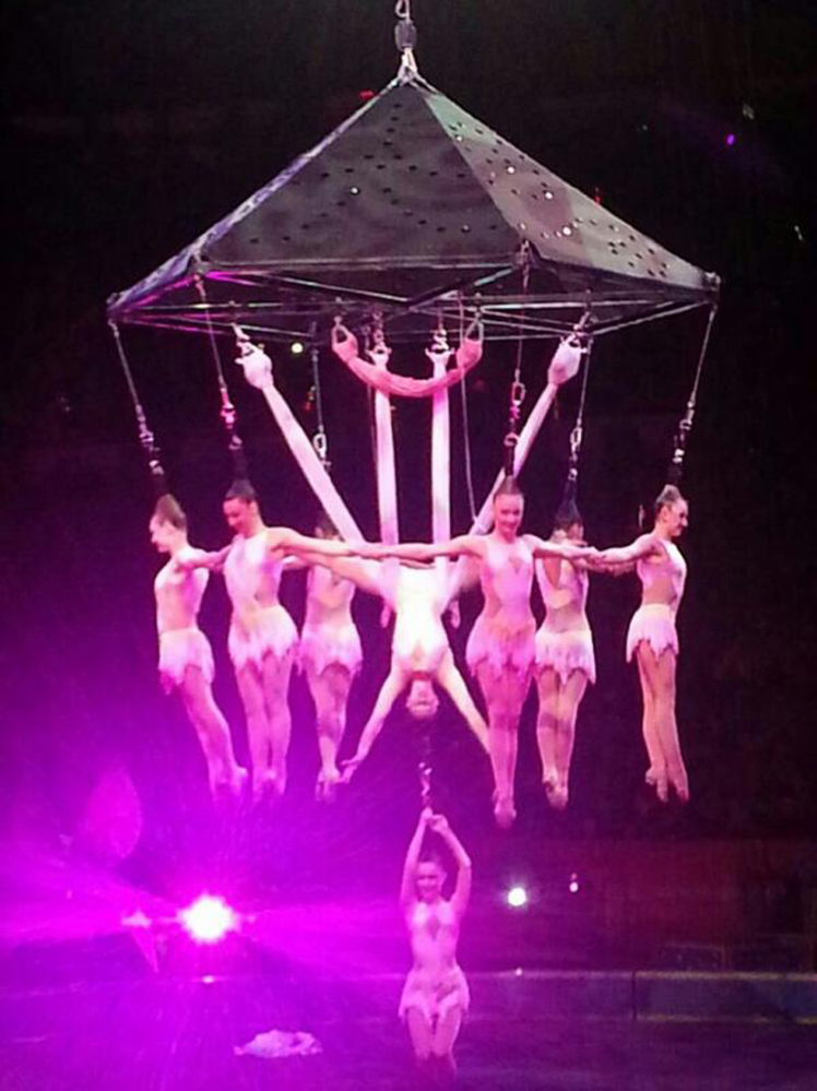 In this photo provided by Frank Caprio, performers hang during an aerial hair-hanging stunt at the Ringling Brothers and Barnum and Bailey Circus, Friday, in Providence, R.I.