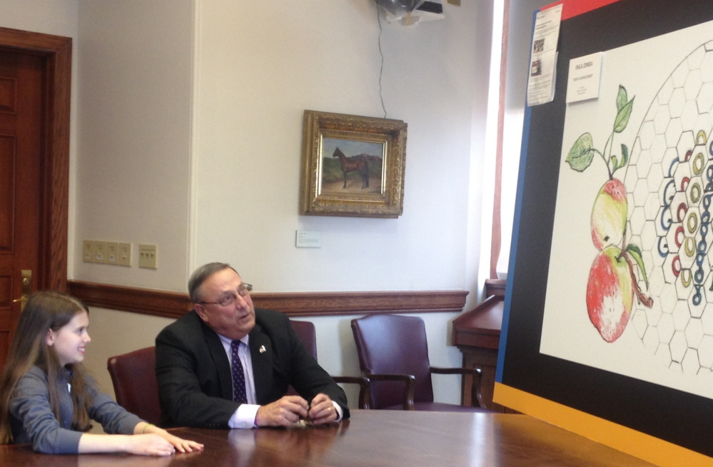 State Winner: Waterville fifth-grader Inga Zimba and Gov. Paul LePage discuss Inga's winning state entry in the national Doodle4Google contest Tuesday at the State House.