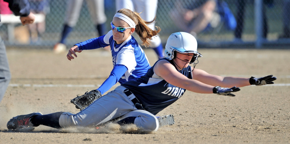 Staff photo by Michael G. Seamans Madison High School's Kayla Bess, 2, tags out Dirigo High School's Kenzie Lord, 9, in Madison on Wednesday. Madison defeated Dirigo 12-0 in six innings.