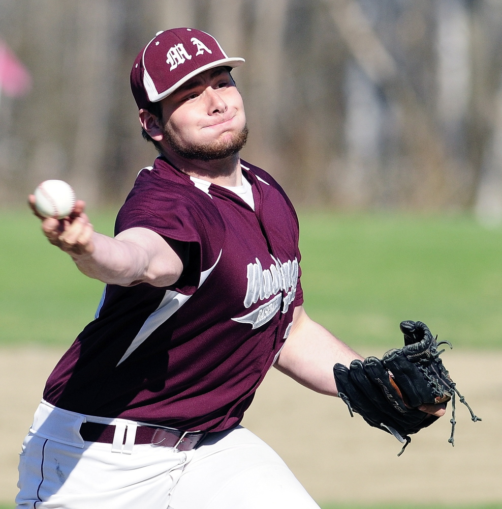 Monmouth Academy pitcher Nate Gagne serves up the ball with a side arm delivery during a game on Wednesday May 7, 2014 at Monmouth Academy. (Photo by Joe Phelan/Staff Photographer)