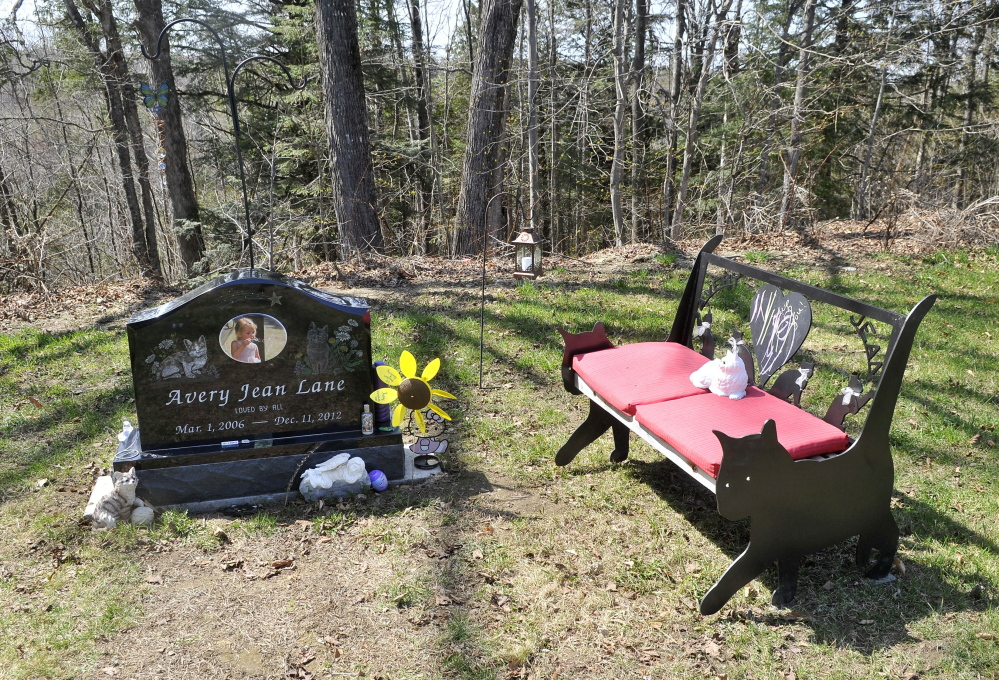 VANDALIZED: Decorations at the grave site of 6-year-old Avery Lane, shown Thursday, have been restored since the site was vandalized recently.