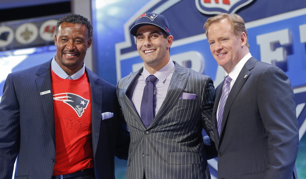 Eastern Illinois quarterback Jimmy Garoppolo poses for photos with NFL commissioner Roger Goodell and former New England Patriots linebacker Willie McGinest after being selected as the 62nd pick by the New England Patriots in the second round of the 2014 NFL draft on Friday.