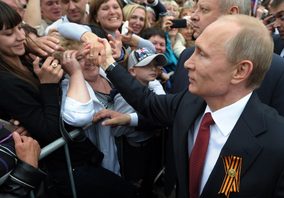 Russian President Vladimir Putin is greeted at celebrations marking Victory Day – which commemorates the defeat of Nazi Germany – on Friday in Sevastopol, Crimea.