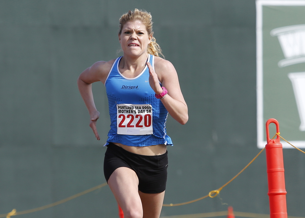 Erica Jesseman nears the finish line at Hadlock Field in winning the women's division of the Portland Sea Dogs Mother's Day 5K on Sunday.