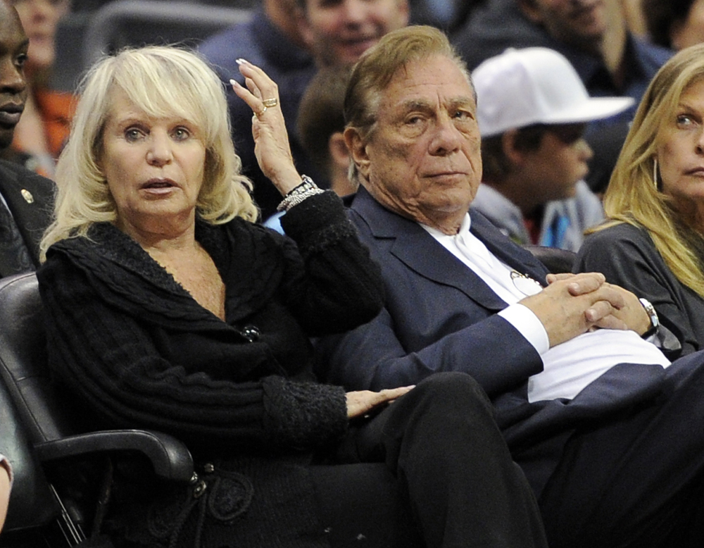 Los Angeles Clippers owner Donald Sterling sits with his wife, Shelly, during a home game in 2010. An attorney representing Shelly Sterling says she will fight to retain her 50 percent ownership of the team.